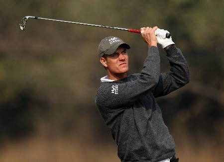 DELHI, INDIA - FEBRUARY 08:  Mads Vibe-Hastrup of Denmark hits his second shot at the 10th hole during the second round of the Emaar-MGF Indian Masters at the Delhi Golf Club, on February 8, 2008 in Delhi, India.  (Photo by David Cannon/Getty Images)