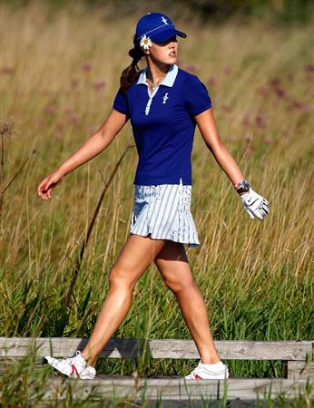 SUGAR GROVE, IL - AUGUST 19:  Michelle Wie of the U.S. Team walks off the first tee during a practice round prior to the start of the 2009 Solheim Cup at Rich Harvest Farms on August 19, 2009 in Sugar Grove, Illinois.  (Photo by Scott Halleran/Getty Images)