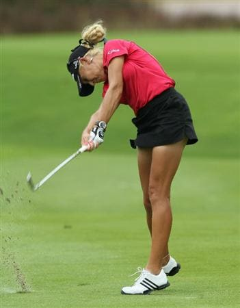 KUALA LUMPUR, MALAYSIA - OCTOBER 22: Natalie Gulbis of the USA plays her 2nd shot on the 11th hole during Round One of the Sime Darby LPGA on October 22, 2010 at the Kuala Lumpur Golf and Country Club in Kuala Lumpur, Malaysia. (Photo by Stanley Chou/Getty Images)
