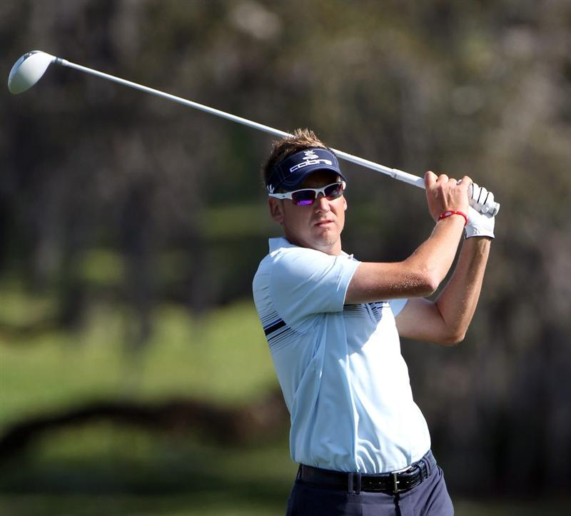 ORLANDO, FL - MARCH 25:  Ian Poulter of England plays a shot on the 16th hole during the second round of the Bay Hill Invitational presented by MasterCard at the Bay Hill Club and Lodge on March 25, 2011 in Orlando, Florida.  (Photo by Sam Greenwood/Getty Images)