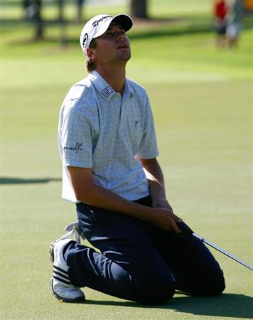 ATLANTA - SEPTEMBER 27:  Sean O'Hair reacts after missing a birdie putt on the 13th green during the final round of THE TOUR Championship presented by Coca-Cola, the final event of the PGA TOUR Playoffs for the FedExCup, at East Lake Golf Club on September 27, 2009 in Atlanta, Georgia.