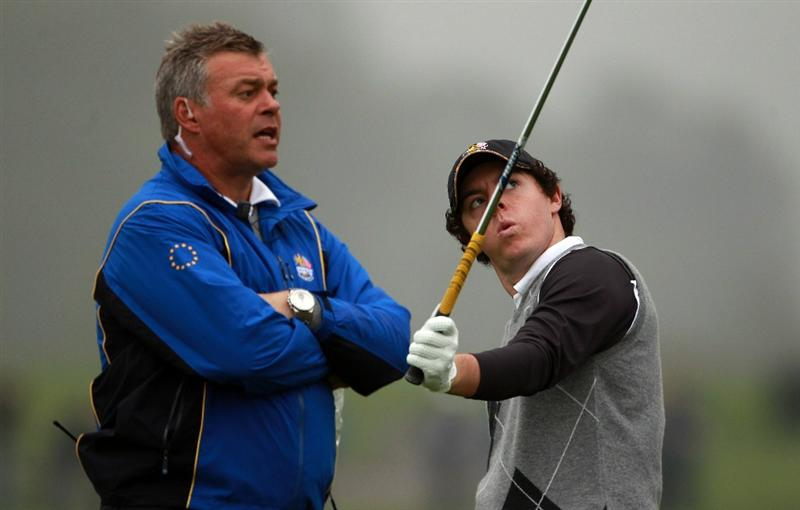 NEWPORT, WALES - SEPTEMBER 28:  Rory McIlroy of Europe chats with Vice Captain Darren Clarke (L) during a practice round prior to the 2010 Ryder Cup at the Celtic Manor Resort on September 28, 2010 in Newport, Wales.  (Photo by Scott Halleran/Getty Images)