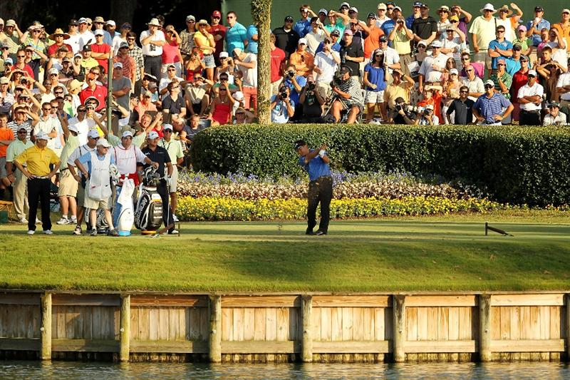 PONTE VEDRA BEACH, FL - MAY 15:  K.J. Choi of South Korea hits his tee shot on the 17th hole during the final round of THE PLAYERS Championship held at THE PLAYERS Stadium course at TPC Sawgrass on May 15, 2011 in Ponte Vedra Beach, Florida.  (Photo by Mike Ehrmann/Getty Images)