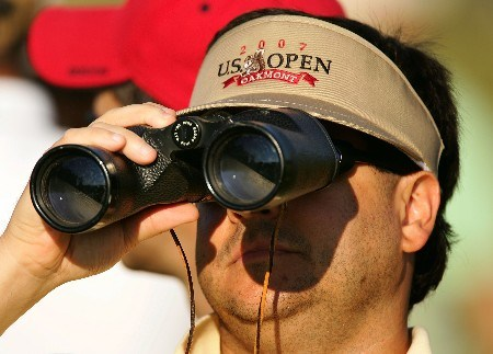 OAKMONT, PA - JUNE 15:  A golf fan uses binoculars to take in the action during the second round of the 107th U.S. Open Championship at Oakmont Country Club on June 15, 2007 in Oakmont, Pennsylvania.  (Photo by Sam Greenwood/Getty Images)