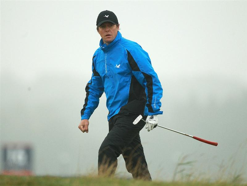 ST ANDREWS, SCOTLAND - OCTOBER 08:  Hollywood actor Hugh Grant on the fourth fairway during the second round of The Alfred Dunhill Links Championship at The Old Course on October 8, 2010 in St Andrews, Scotland.  (Photo by Warren Little/Getty Images)