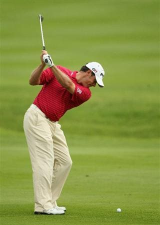 SUN CITY, SOUTH AFRICA - DECEMBER 02:  Lee Westwood of England plays his second shot into the seventh hole during the first round of the 2010 Nedbank Golf Challenge at the Gary Player Country Club Course  on December 2, 2010 in Sun City, South Africa.  (Photo by Warren Little/Getty Images)