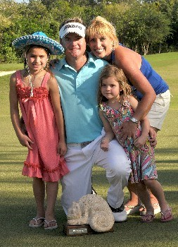 QUINTANA ROO, MEXICO - FEBRUARY 24:  Brian Gay poses with his family, wife Kimberly and daughters, Makinley and Brantley  and the winners trophy after the fourth and final round of the Mayakoba Golf Classic at Riviera Maya on Sunday, February 24, 2008 in Playa del Carmen, Quintana Roo, Mexico  (Photo by Marc Feldman/Getty Images)