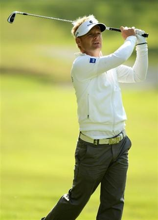 VIRGINIA WATER, ENGLAND - MAY 20:  Soren Kjeldsen of Denmark hits an approach shot during the first round of the BMW PGA Championship on the West Course at Wentworth on May 20, 2010 in Virginia Water, England.  (Photo by Ross Kinnaird/Getty Images)