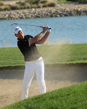 DOHA, QATAR - FEBRUARY 04:  Robert Karlsson of Sweden plays a bunker shot on the 13th hole during the second round of the Commercialbank Qatar Masters held at Doha Golf Club on February 4, 2011 in Doha, Qatar.  (Photo by Andrew Redington/Getty Images)