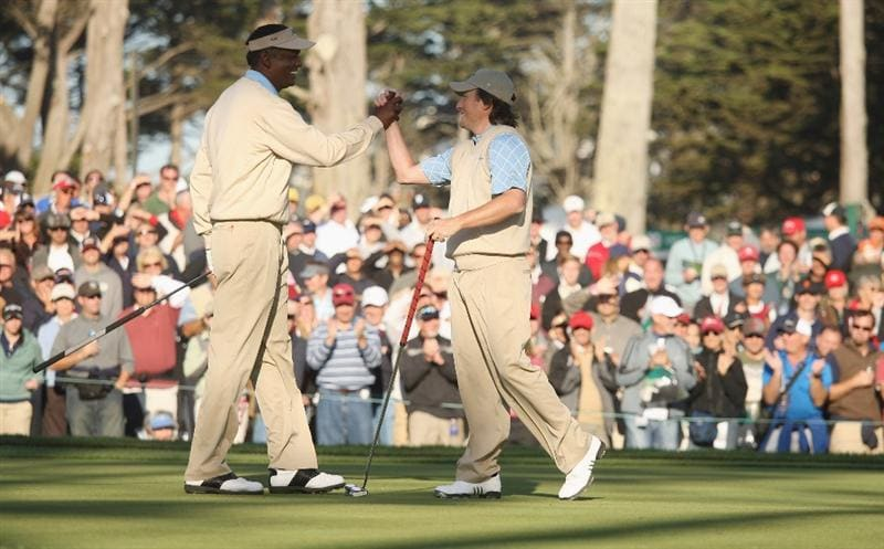 SAN FRANCISCO - OCTOBER 09:  Vijay Singh and Tim Clark of the International Team celebrate after winning their match against Lucas Glover and Stewart Cink of the USA Team during the Day Two Fourball Matches of The Presidents Cup at Harding Park Golf Course on October 9, 2009 in San Francisco, California.  (Photo by Warren Little/Getty Images)