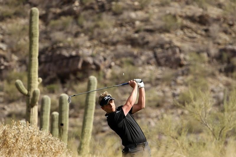 MARANA, AZ - FEBRUARY 25:  Luke Donald of England hits his tee shot on the 16th hole during the third round of the Accenture Match Play Championship at the Ritz-Carlton Golf Club on February 25, 2011 in Marana, Arizona.  (Photo by Andy Lyons/Getty Images)