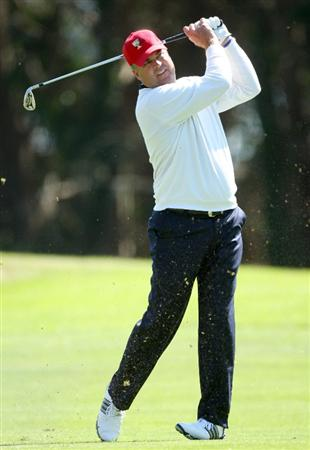 SAN FRANCISCO - OCTOBER 09:  Kenny Perry of the USA Team hits his second shot at the 10th hole during the Day Two Fourball Matches in The Presidents Cup at Harding Park Golf Course on October 9, 2009 in San Francisco, California  (Photo by David Cannon/Getty Images)
