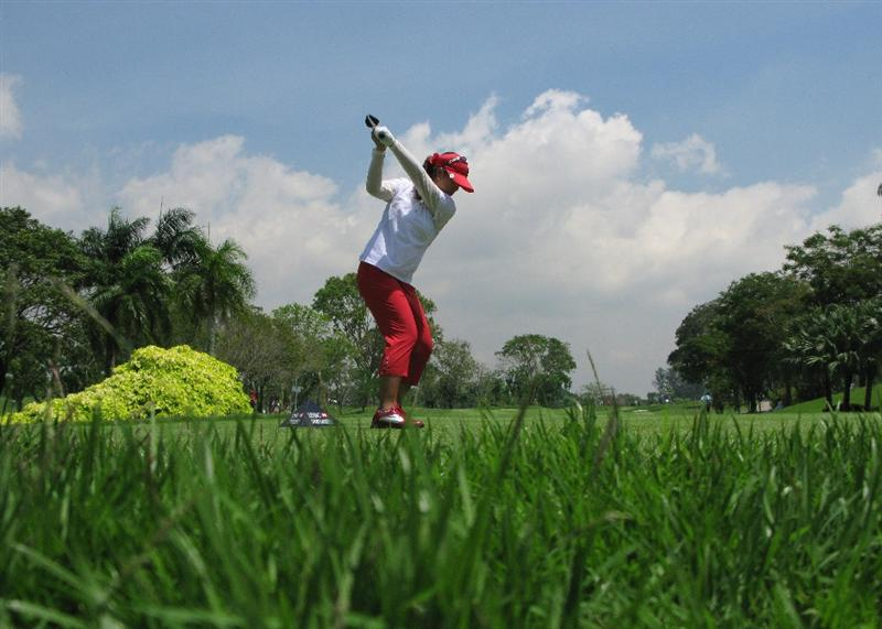 SINGAPORE - MARCH 06: Shanshan Feng of China in action during the second round of the HSBC Women's Champions at Tanah Merah Country Club on March 6, 2009 in Singapore.  (Photo by Andrew Redington/Getty Images)