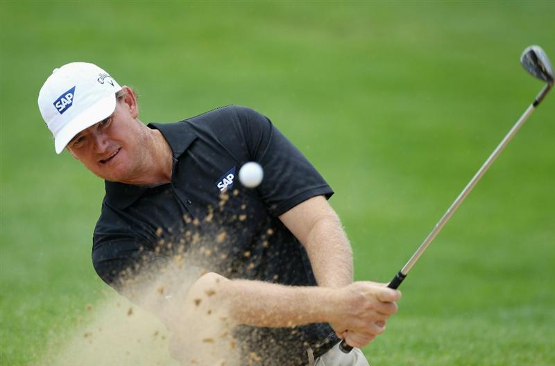 SUN CITY, SOUTH AFRICA - DECEMBER 01:  Ernie Els of South Africa plays out of the first greenside bunker during the pro-am for the 2010 Nedbank Golf Challenge at the Gary Player Country Club Course  on December 1, 2010 in Sun City, South Africa.  (Photo by Warren Little/Getty Images)