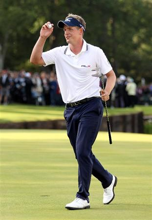 VIRGINIA WATER, ENGLAND - MAY 29:  Luke Donald of England acknowledges the crowd on the 18th green during the final round of the BMW PGA Championship  at the Wentworth Club on May 29, 2011 in Virginia Water, England.  (Photo by Richard Heathcote/Getty Images)