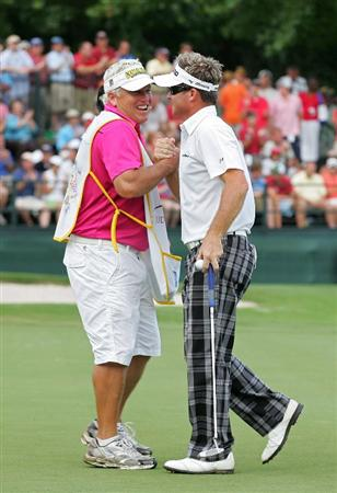 MEMPHIS, TN - JUNE 14:  Brian Gay of the United States celebrates his victory with his caddie Kip Henley on the 18th green during the final round of the St. Jude Classic at TPC Southwind held on June 14, 2009 in Memphis, Tennessee.  (Photo by Michael Cohen/Getty Images)