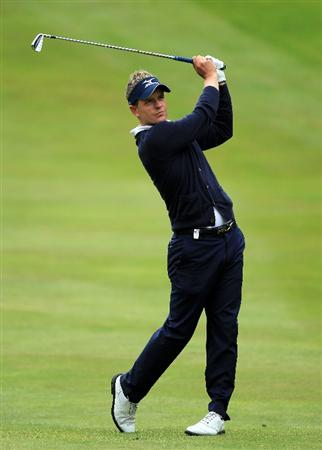 VIRGINIA WATER, ENGLAND - MAY 29:  Luke Donald of England hits his 2nd shot on the 4th hole during the final round of the BMW PGA Championship  at the Wentworth Club on May 29, 2011 in Virginia Water, England.  (Photo by David Cannon/Getty Images)