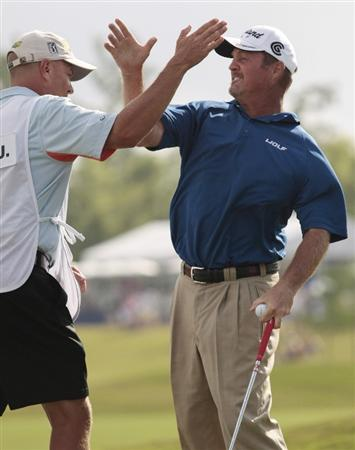 AVONDALE, LA - APRIL 26:  Jerry Kelly (R) reacts with his caddie Eric Meller after his win during the final round of the Zurich Classic at TPC Louisiana on April 26, 2009  in Avondale, Louisiana. (Photo by Dave Martin/Getty Images)