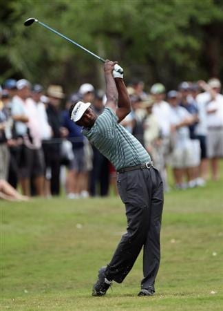DORAL, FL - MARCH 10:  Vijay Singh of Fiji hits a  shot on the tenth hole during the first round of the 2011 WGC- Cadillac Championship at the TPC Blue Monster at the Doral Golf Resort and Spa on March 10, 2011 in Doral, Florida.  (Photo by Sam Greenwood/Getty Images)