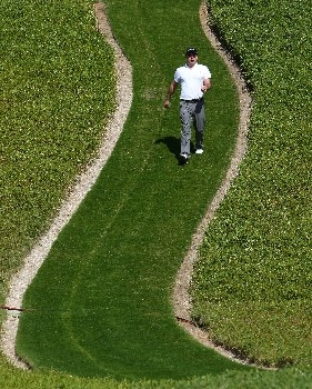ABU DHABI, UNITED ARAB EMIRATES - JANUARY 20:  Paul McGinley of Ireland walks towards his ball on the third hole during the final round of The Abu Dhabi Golf Championship at Abu Dhabi Golf Club on January 20, 2008 in Abu Dhabi.  (Photo by Andrew Redington/Getty Images)