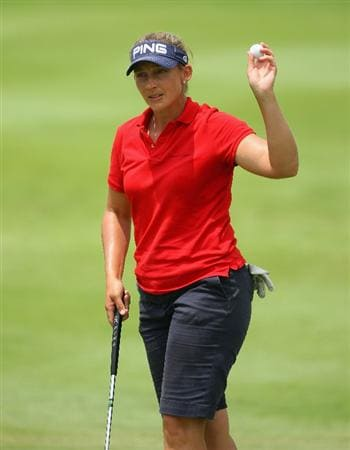 SINGAPORE - MARCH 07:  Angela Stanford of the USA waves to the crowd on the 16th hole during the third round of the HSBC Women's Champions at Tanah Merah Country Club on March 7, 2009 in Singapore.  (Photo by Andrew Redington/Getty Images)