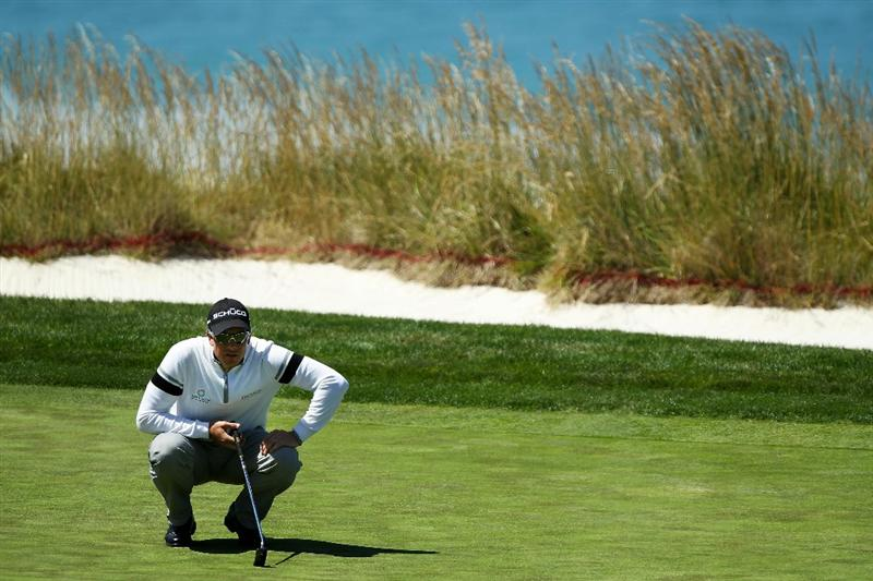 PEBBLE BEACH, CA - JUNE 17:   Henrik Stenson of Sweden waits on the tenth green during the first round of the 110th U.S. Open at Pebble Beach Golf Links on June 17, 2010 in Pebble Beach, California.  (Photo by Donald Miralle/Getty Images)