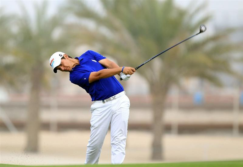 BAHRAIN, BAHRAIN - JANUARY 29:  Matteo Manassero of Italy plays his second shot at the 9th hole during the third round of the 2011 Volvo Champions held at the Royal Golf Club on January 29, 2011 in Bahrain, Bahrain.  (Photo by David Cannon/Getty Images)