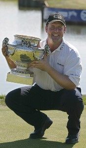 John Bickerton of England holds the trophy after winning the 100th Open de France Alstom at Le Golf National in St Quentin near Paris, France on July 2, 2006.Photo by Alexanderk/WireImage.com