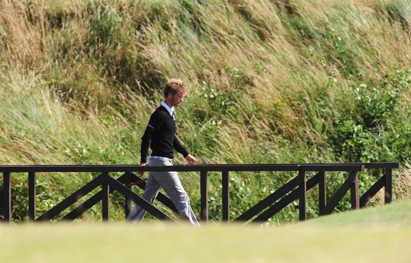 TURNBERRY, SCOTLAND - JULY 19:  Chris Wood of England crosses the bridge on the 16th hole during the final round of the 138th Open Championship on the Ailsa Course, Turnberry Golf Club on July 19, 2009 in Turnberry, Scotland.  (Photo by Stuart Franklin/Getty Images)