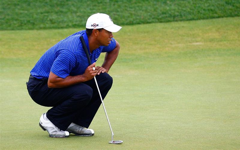 JERSEY CITY, NJ - AUGUST 29:  Tiger Woods lines up his putt on the 12th green during round three of The Barclays on August 29, 2009 at Liberty National in Jersey City, New Jersey.  (Photo by Kevin C. Cox/Getty Images)