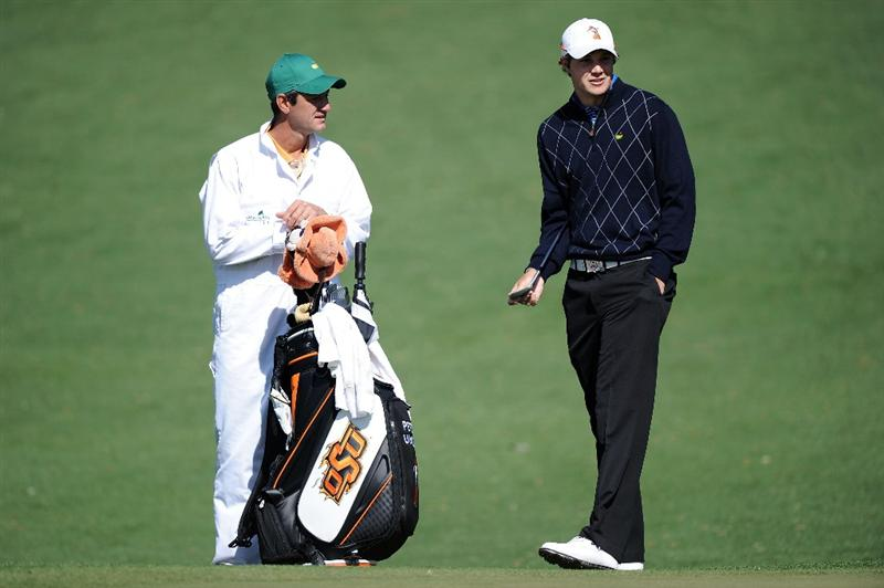 AUGUSTA, GA - APRIL 05:  Amateur Peter Uihlein chats with his caddie Alan Bratton during a practice round prior to the 2011 Masters Tournament at Augusta National Golf Club on April 5, 2011 in Augusta, Georgia.  (Photo by Harry How/Getty Images)