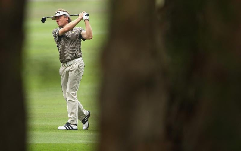 HONG KONG, CHINA - NOVEMBER 22:  Bernhard Langer of Germany plays his approach shot on the third hole during the third round of the UBS Hong Kong Open at the Hong Kong Golf Club on November 22, 2008 in Fanling, Hong Kong.  (Photo by Stuart Franklin/Getty Images)