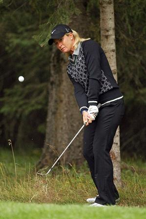CALGARY, AB - SEPTEMBER 06 : Suzann Pettersen of Norway hits her second shot out of the woods on the eighth hole during the final round of the Canadian Women's Open at Priddis Greens Golf & Country Club on September 6, 2009 in Calgary, Alberta, Canada. (Photo by Hunter Martin/Getty Images)