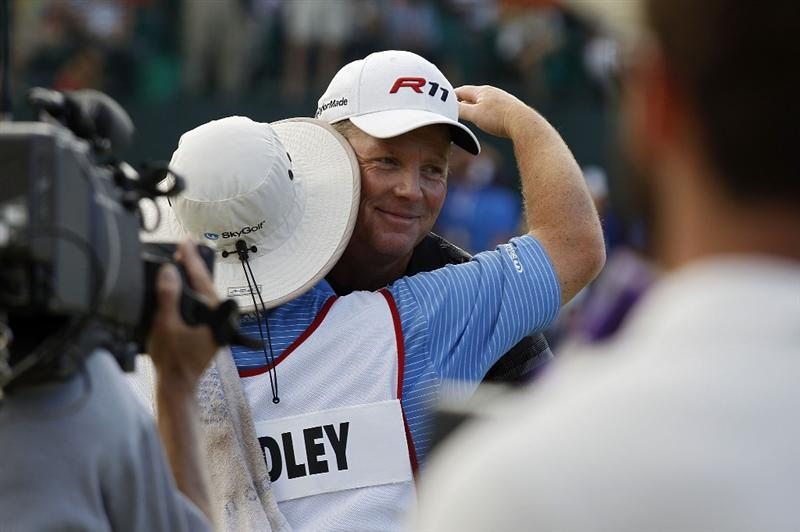 RIO GRANDE, PR - MARCH 13: Michael Bradley is congratulated by his caddie after winning the Puerto Rico Open presented by seepuertorico.com at Trump International Golf Club on March 13, 2011 in Rio Grande, Puerto Rico.  (Photo by Michael Cohen/Getty Images)