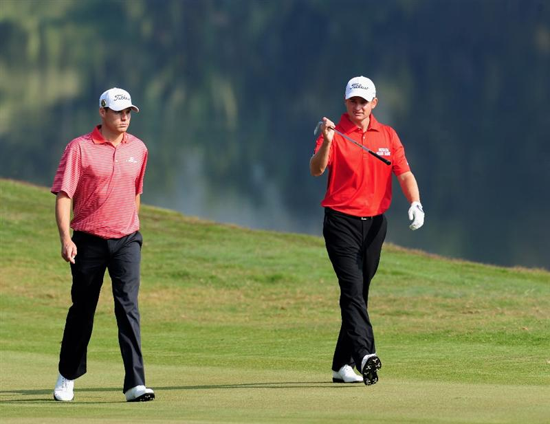 SHENZHEN, GUANGDONG - NOVEMBER 25: Nick Watney and John Merrick of USA during the pro - am at the Omega Mission Hills World Cup on the Olazabal course on November 25, 2009 in Shenzhen, China. (Photo by Stuart Franklin/Getty Images)