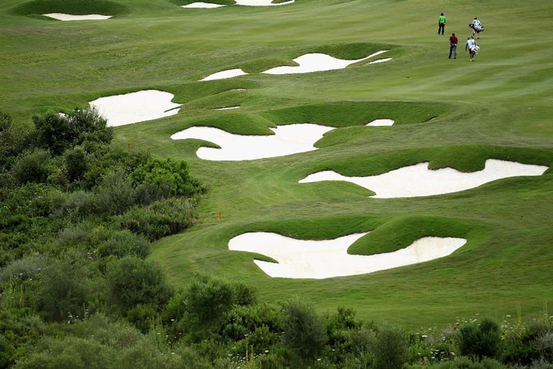 CASARES, SPAIN - MAY 20:  Francesco Molinari of Italy and Paul Lawrie of Scotland walk up the 15th fairway during the group stages of the Volvo World Match Play Championships at Finca Cortesin on May 20, 2011 in Casares, Spain.  (Photo by Warren Little/Getty Images)