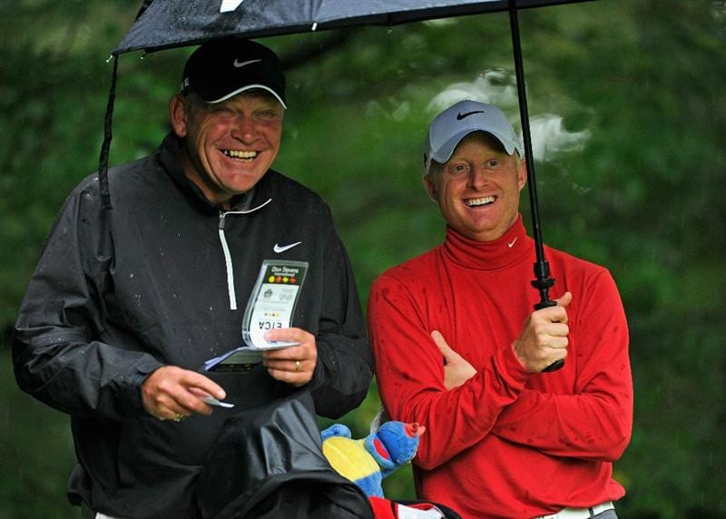 HILVERSUM, NETHERLANDS - SEPTEMBER 08:  Simon Dyson of England and caddie Guy Tilson during the Pro-Am at The KLM Open Golf at The Hillversumsche Golf Club on September 8, 2010 in Hilversum, Netherlands.  (Photo by Stuart Franklin/Getty Images)