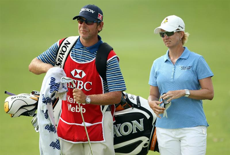 SINGAPORE - FEBRUARY 27:  Karrie Webb of Australia stands with her caddie Michael Paterson on the first hole during the final round of the HSBC Women's Champions at the Tanah Merah Country Club on February 27, 2011 in Singapore.  (Photo by Andrew Redington/Getty Images)