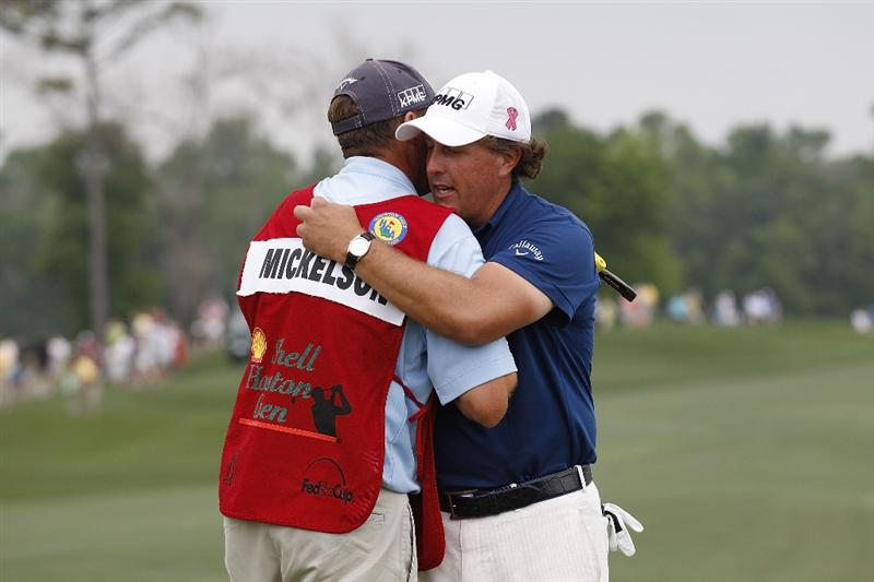 HUMBLE, TX - APRIL 03:  Phil Mickelson (R) hugs his caddie James Mackay after winning the Shell Houston Open at Redstone Golf Club on April 3, 2011 in Humble, Texas.  (Photo by Michael Cohen/Getty Images)