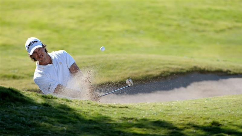 LAS VEGAS - OCTOBER 17:   Aaron Baddeley chips out of the greenside bunker on the 17th hole during the third round of the Justin Timberlake Shriners Hospitals for Children Open at the TPC Summerlin on October 17, 2009  in Las Vegas, Nevada. (Photo by Marc Feldman/Getty Images)