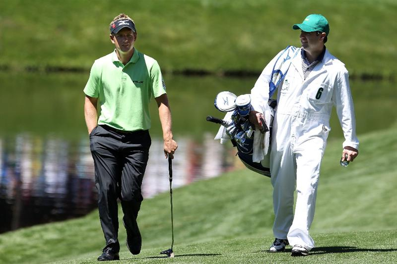 AUGUSTA, GA - APRIL 06:  Luke Donald of England walks with his caddie during the Par 3 Contest prior to the 2011 Masters Tournament at Augusta National Golf Club on April 6, 2011 in Augusta, Georgia.  (Photo by Andrew Redington/Getty Images)