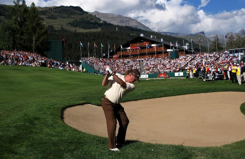 CRANS, SWITZERLAND - SEPTEMBER 05:  Miguel Angel Jimenez of Spain plays his second shot into the 18th green during the final round of The Omega European Masters at Crans-Sur-Sierre Golf Club on September 5, 2010 in Crans Montana, Switzerland.  (Photo by Warren Little/Getty Images)