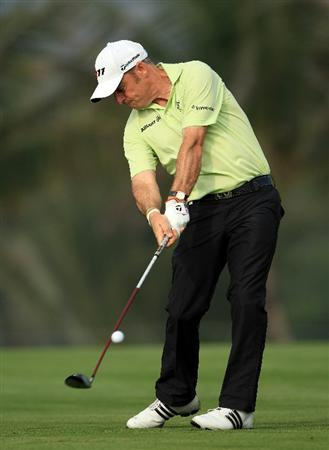 DUBAI, UNITED ARAB EMIRATES - FEBRUARY 10:  Paul McGinley of Ireland in action during the first round of the Omega Dubai Desert Classic on the Majlis course at the Emirates Golf Club on February 10, 2011 in Dubai, United Arab Emirates.  (Photo by Andrew Redington/Getty Images)