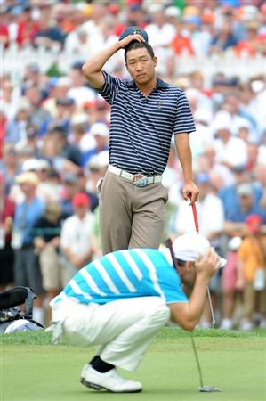 LOUISVILLE, KY - SEPTEMBER 20:  Anthony Kim of the USA team watches as Oliver Wilson of the European team lines up a putt on the 14th green during the morning foursome matches on day two of the 2008 Ryder Cup at Valhalla Golf Club on September 20, 2008 in Louisville, Kentucky.  (Photo by Harry How/Getty Images)