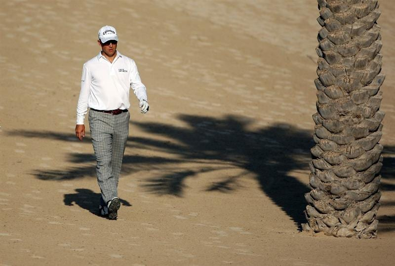 DUBAI, UNITED ARAB EMIRATES - JANUARY 30:  Niclas Fasth of Sweden walks towards his ball on the 14th hole during the second round of the Dubai Desert Classic on the Majilis course at Emirates Golf Club on January 30, 2009 in Dubai, United Arab Emirates.  (Photo by Andrew Redington/Getty Images)