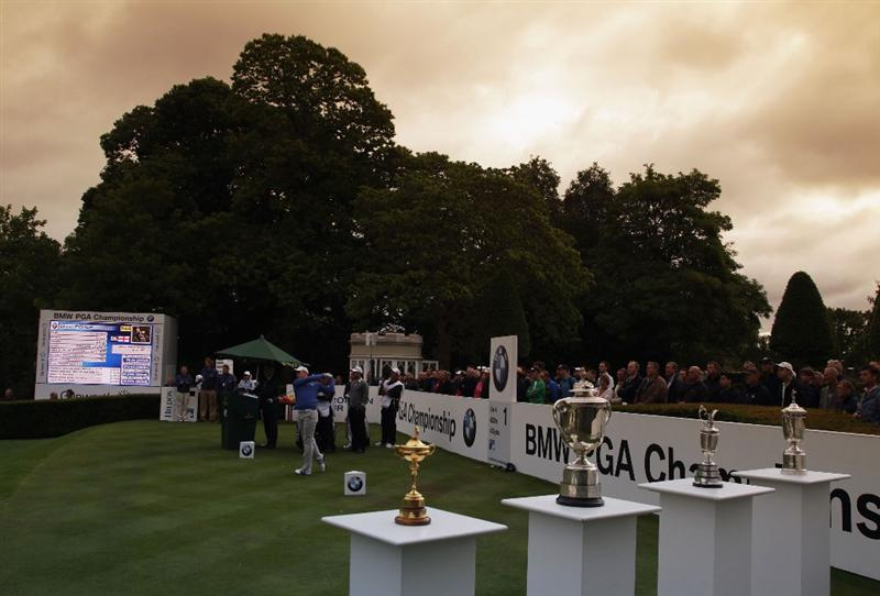 VIRGINIA WATER, ENGLAND - MAY 26:  (EDITORS NOTE: THIS IMAGE WAS TAKEN WITH A GRADUATED FILTER) Oliver Fisher of England tees off on the first hole during the first round of the BMW PGA Championship at Wentworth Club on May 26, 2011 in Virginia Water, England.  (Photo by David Cannon/Getty Images)