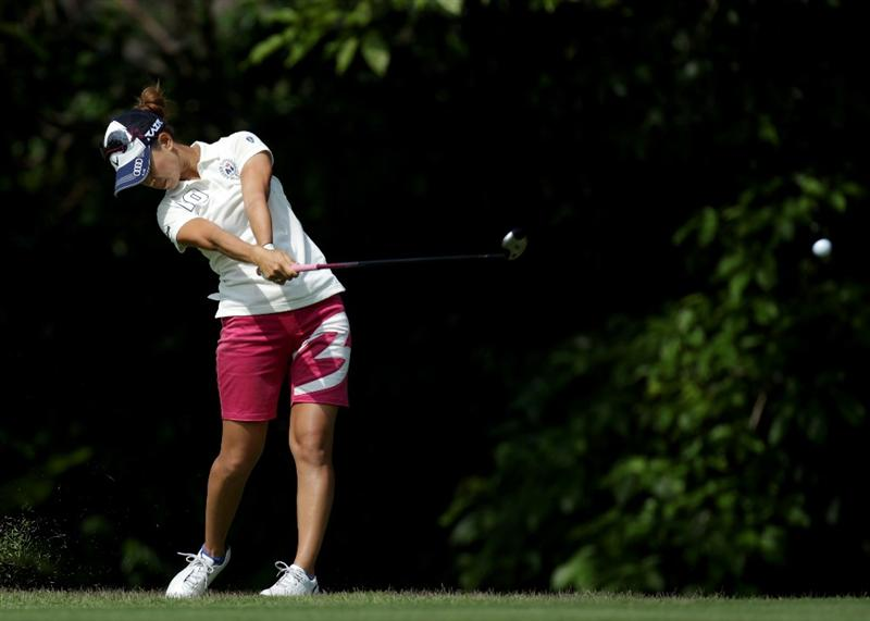 SINGAPORE - FEBRUARY 24:  Momoko Ueda of Japan  during the first round of the HSBC Women's Champions at Tanah Merah Country Club  on February 24, 2011 in Singapore, Singapore.  (Photo by Ross Kinnaird/Getty Images)