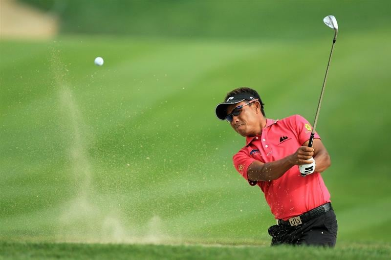 DUBAI, UNITED ARAB EMIRATES - FEBRUARY 11:  Thongchai Jaidee of Thailand plays his second shot at the 14th hole during the second round of the 2011 Omega Dubai Desert Classic on the Majilis Course at the Emirates Golf Club on February 11, 2011 in Dubai, United Arab Emirates.  (Photo by David Cannon/Getty Images)