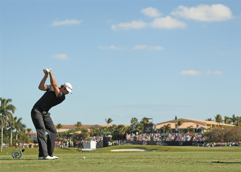 DORAL, FL - MARCH 13:  Dustin Johnson hits his tee shot on the ninth hole during the final round of the 2011 WGC- Cadillac Championship at the TPC Blue Monster at the Doral Golf Resort and Spa on March 13, 2011 in Doral, Florida.  (Photo by Mike Ehrmann/Getty Images)