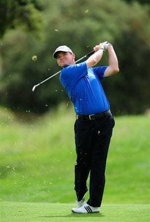 MADRID, SPAIN - MAY 27:  Paul Lawrie of Scotland plays his approach shot on the fourth hole during the first round of the Madrid Masters at Real Sociedad Hipica Espanola Club De Campo on May 27, 2010 in Madrid, Spain.  (Photo by Stuart Franklin/Getty Images)